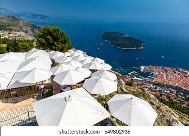 Dubrovnik Croatia. Top view over restaurant with sun umbrellas and the old town below.