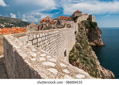 Dubrovnik, Croatia view from city walls overlooking walls and sea with cliffs during the day