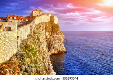 Dubrovnik, Croatia view from city walls overlooking walls and sea with cliffs at blue sky. Croatia