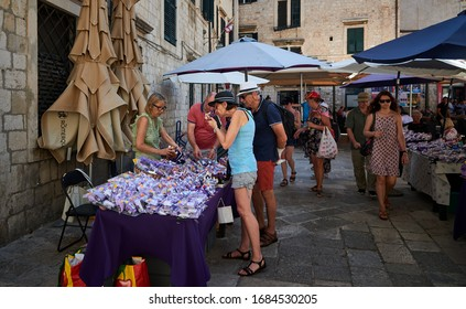 DUBROVNIK, CROATIA-July 1, 2019: Tourists shopping and bargaining in local markets for souvenirs and trinkets in Old Town Croatia.