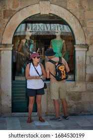 DUBROVNIK, CROATIA-July 1,2019: A tourist couple loitering in old town Dubrovnik