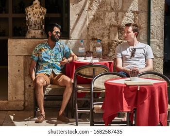 DUBROVNIK, CROATIA-JULY1, 2019: Two friends having a leisurely chat in a pub in Old Town Dubrovnik