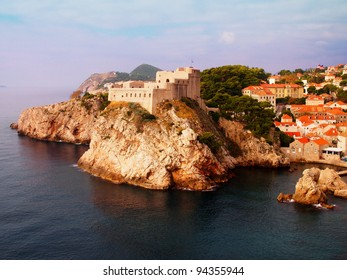 Dubrovnik fortress, Fortress on cliff surrounded by sea and red-tiled houses
