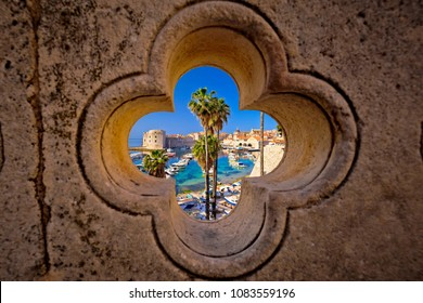 Dubrovnik harbor view from Ploce gate through stone carved detail, Dalamtia region of Croatia