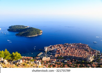 Dubrovnik Old Town and the Lokrum island on the Adriatic Sea in Croatia, aerial view