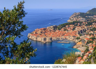 Dubrovnik old town surrounded by fortified walls above the Adriatic sea, Croatia. Picturesque view on the old town (medieval Ragusa) and Dalmatian Coast of Adriatic Sea.