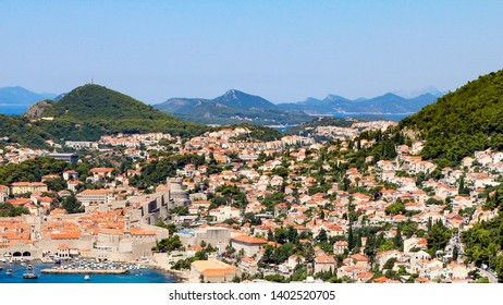 Dubrovnik in Summer, Rocky Coastline, Dubrovnik kayaking, fly board. Diving / jumping from the rocks. People on the beach. Adriatic beach. Beach holiday