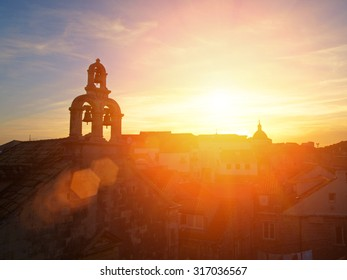 Dubrovnik walls, bell tower and sunset, Croatia, Balkan Peninsula, Europe