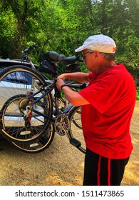 Dubuque, Iowa, June 2019, man loading up bikes after an envigorating bike ride on Heritage Trail.