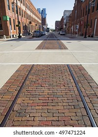 Dubuque, Iowa, October 2016: Decommissioned train tracks run down the street of the historic Millwork District in Dubuque, Iowa.