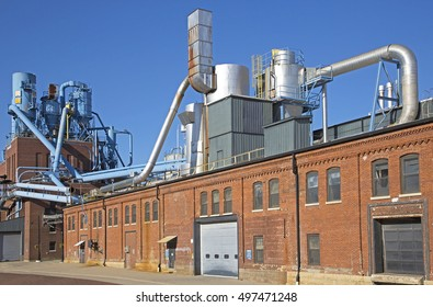 Dubuque Iowa, October 2016: A manufacturing plant in the historic Millwork District of Dubuque, Iowa sits under a blue sky on a warm October day.