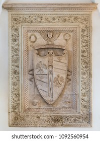 Duchy of Urbino and Montefeltro Family coat of arms in the Ducal Palace of Urbino, city and World Heritage Site in the Marche region of Italy. May-13-2018