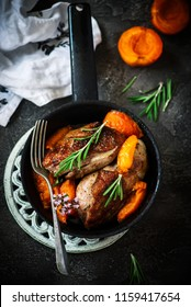 Duck breast with apricots .dark photo .style vintage.selective focus