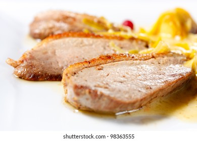 Duck Breast Baked with Apples and cranberries. Tasty and nutritious