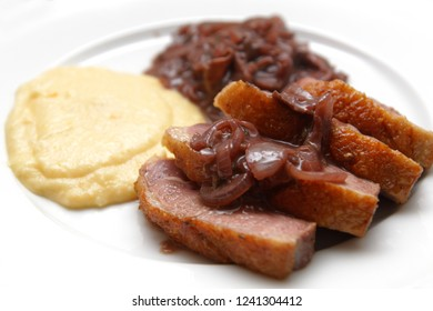 duck breast with mashed potato and redwine onion sauce