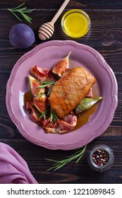 Duck breast with pancetta, rosemary and figs, baked in honey sauce. vertical