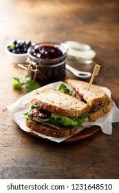 Duck breast sandwich with berry sauce and avocado