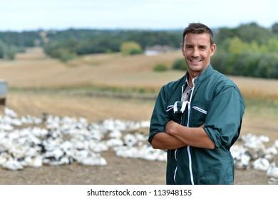 Duck breeder standing outside the farm