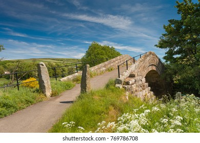 Duck Bridge in the North York Moors national park. This is an old packhorse bridge made of stone which is a tourist attraction