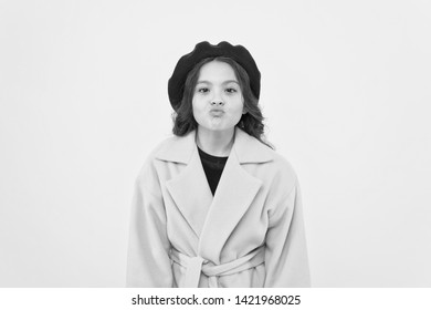 Duck face concept. Fashionable kid funny grimace face. Little fashionista posing. Kid funny face stand yellow background. Funny mimic expression. Kiss lips or funny duck face. Posing for camera.
