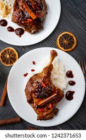 Duck leg confit with rice and goji berries. Traditional french cuisine. View from above.