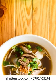 Duck noodle and wood table background