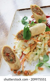 duck spring roll with salad