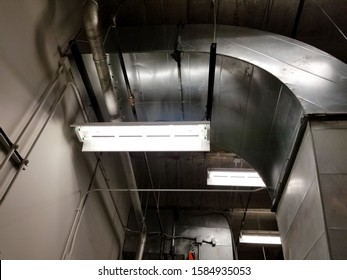 Duct round elbow and sheet metal ductwork in mechanical room