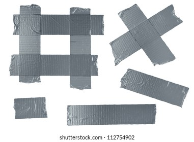 Duct tape or duck tape torn strips of isolated elements of strong adhesive gray material used in packaging boxes or repairing or fixing broken things that need to be sealed air tight.