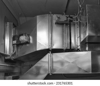 Ductwork with damper actuator controls air flow into an air conditioned space. Smoke detector in housing samples air for combustion.
