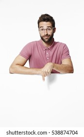 Dude pointing down in white studio
