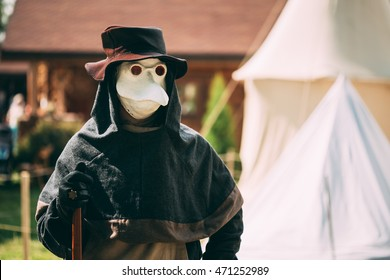 DUDUTKI, BELARUS - JULY 19, 2014: Plague doctor - participant of festival of medieval culture