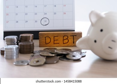 Due for repayment There are coins, calculators and calendar reminders placed on the table.