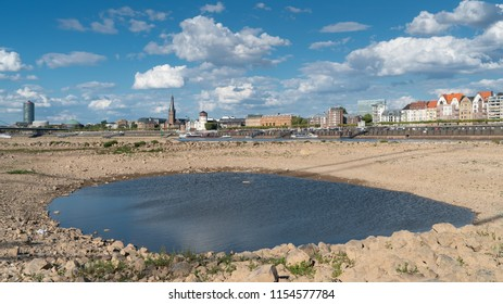 DUESSELDORF, GERMANY - AUGUST 10, 2018: Drought in Germany, low water of the Rhine river with the cityscape of Duesseldorf on August 10, 2018 in Germany