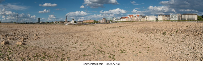 DUESSELDORF, GERMANY - AUGUST 11, 2018: Drought in Germany, low water of the Rhine river with the cityscape of Duesseldorf on August 11, 2018 in Germany