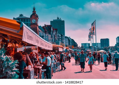 DUESSELDORF, GERMANY - AUGUST 17, 2016: Visitors enjoy the Rhine promenade with its historic houses along river Rhine