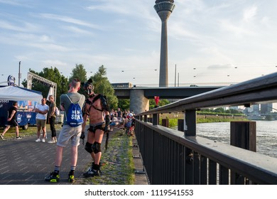 Duesseldorf, Germany - June 04, 2018: Men celebrating at the Gay Pride party at the Rhine river.