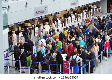 DUESSELDORF, GERMANY - October 10, 2019: Crowd of people are waiting infront of Eurowings counter