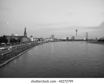 Duesseldorf skyline at night with Rheinturm and river
