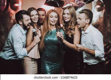Duet. Karaoke Club. Celebration. Great Mood. Bar. Young People. Sing. Microphone. Trendy Modern Nightclub. Party Maker. Birthday. Celebration. Handsome Men. Beautiful Girls. Fashoin.