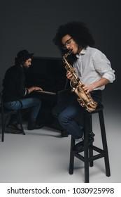 duet of musicians  on black