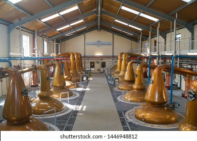 DUFFTOWN, MORAY, SCOTLAND - MAY 11 2017: The copper stills in the Glenfiddich Whisky distillery still house in Dufftown, Scotland