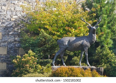 """Dufftown, Speyside, Scotland - May 11 2017: The deer statue in front of the Glenfiddich distillery. Glenfiddich means """"Valley of the deer"""" in Scottish Gaelic"""