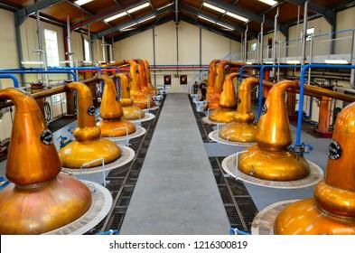 DUFFTOWN, UNITED KINGDOM - 5 SEPTEMBER 2013: Interior of Glenfiddich distillery hall with still pots