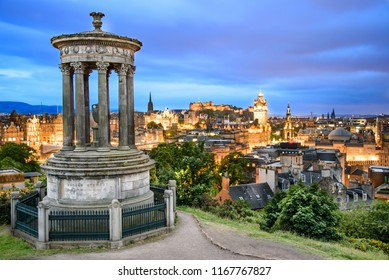 Dugald Stewart Monument with Edinburgh Caste and city in background.