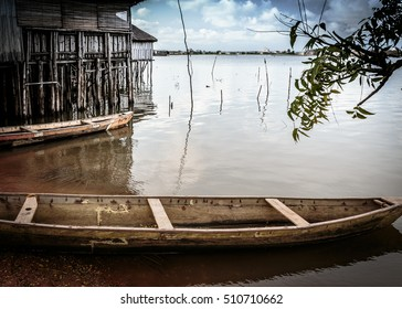 A dugout canoe beached on the shore of Lake Aheme in Benin, West Africa.