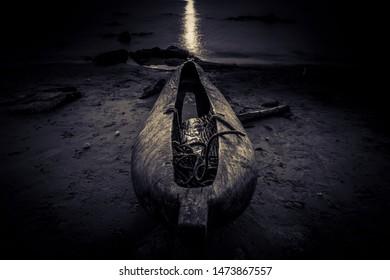 dugout fishermen canoe at the Beach, sunrise on Lake Malawi, South-East-Africa