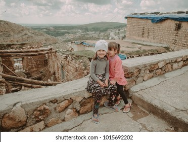 duhok,Iraq - March 20, 2016: Escaped syrian kurdish girls living in Iraqi northern part with thier mother after ISIS attacked thier village