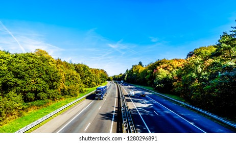 Duinen, Gelderland/the Netherlands - Oct. 5, 2018: View of traffic on the A28 or E232 Freeway between Zwolle and Amesfoort. Viewed from the overpass of the Hierderweg