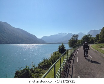 Duingt, France - July 17, 2018: all along the lake one has bicycle paths but the one on the west side is self standing (no cars)